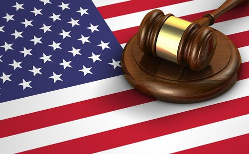 The idea of the right to felony criminal defense is illustrated with a flag and gavel.
